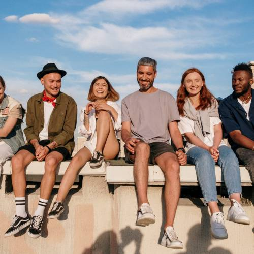 young people sitting on a wall